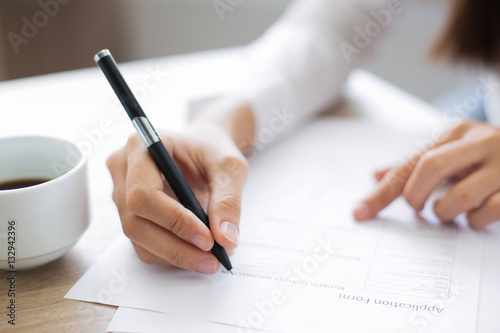 Photo Closeup of Applicant Completing Application Form