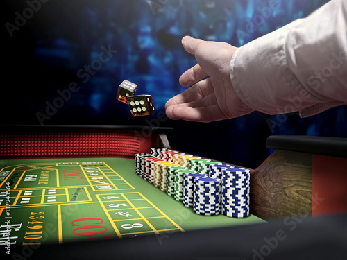 dice throw on craps table at casino Canvas Print