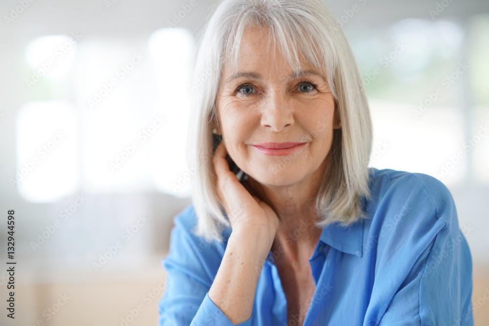 Fototapeta Portrait of senior woman with blue shirt