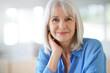 Leinwanddruck Bild - Portrait of senior woman with blue shirt