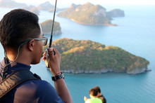 Rescue Use Radio To Secure The Tourists On The Mountain At Ang Thong Archipelago Island, Thailand. May 5, 2016.
