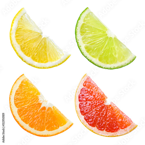 Photo  Citrus fruit. Orange, lemon, lime, grapefruit. Slices isolated o