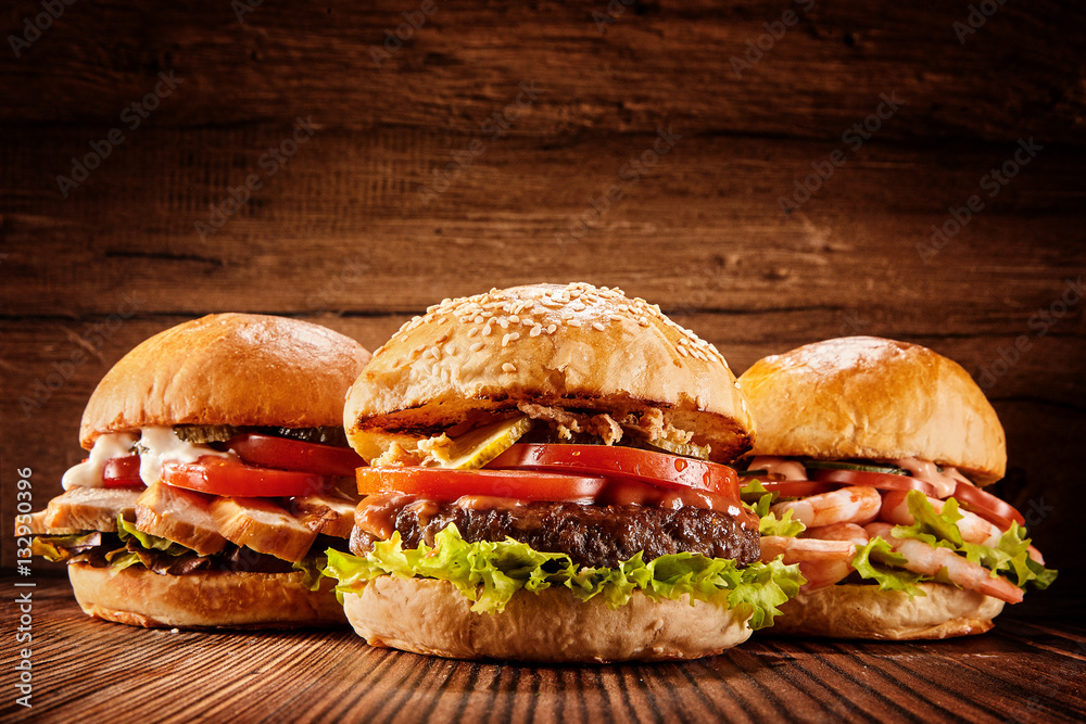 Fototapety, obrazy: Large chicken, beef and shrimp burgers