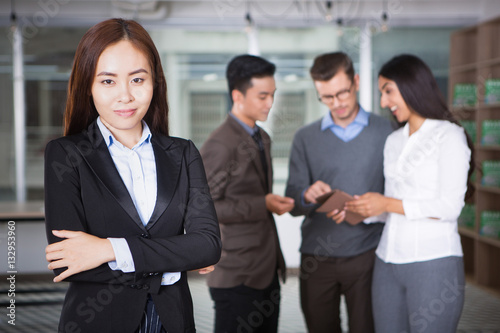 Fototapety, obrazy: Content Young Asian Business Woman and Coworkers