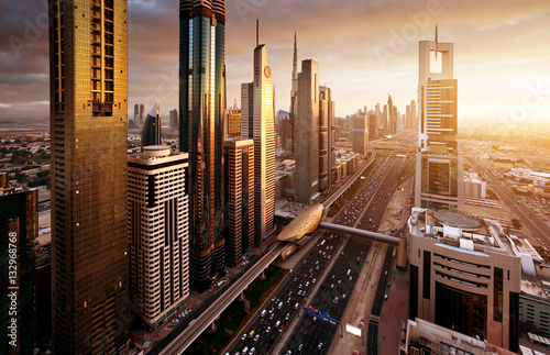 Photo sur Aluminium Moyen-Orient Dubai skyline in sunset time, United Arab Emirates