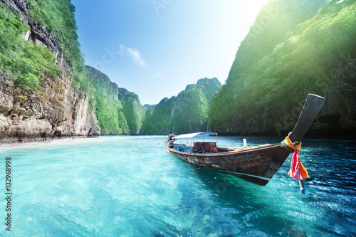 Photo Stands Light blue boat and beautiful sea, Phi Phi island, Thailand