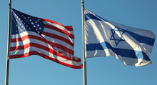 American And Israeli Flags Waving In The Blue Sky