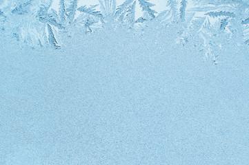 Winter background, frost on window. Patterns made by frost on glass