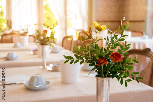 Flowers With Leaves In Vase Food Joint Interior Varied Menu And