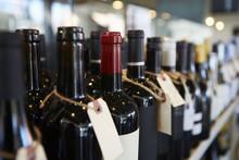 Bottles Of Wine On Display In Delicatessen