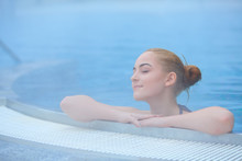 Young Woman In Outside Thermal Pool, Relaxed