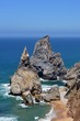 Lonely beach with beautiful rock formation on the coast of Portugal near Sintra and Cabo da Roca