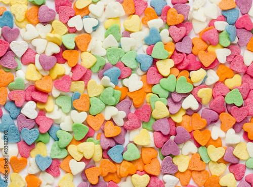 Keuken foto achterwand Snoepjes Colorful sugar sprinkles shaped heart for ice cream cake dessert