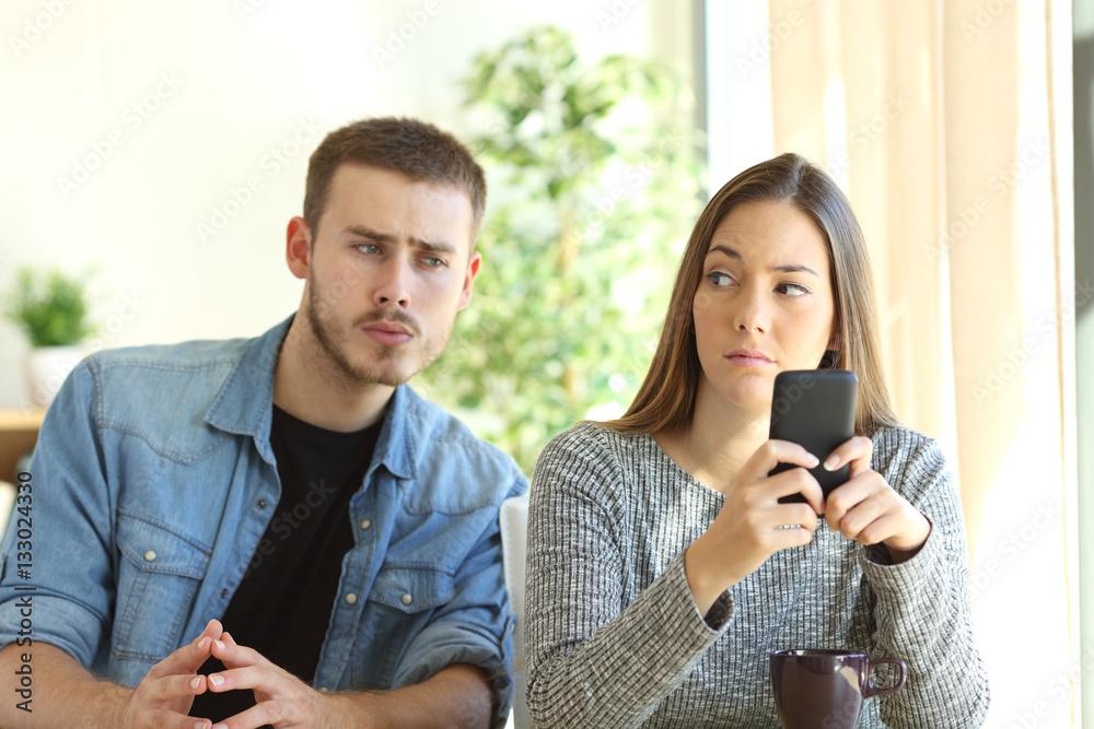 Fototapeta Jealous boyfriend spying his girlfriend