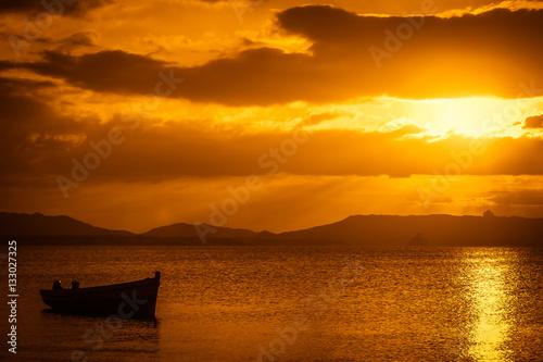 Staande foto Zeilen Boat at sunset