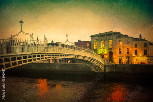 Vintage textured image of Dublin Ireland at Ha'penny bridge over the River Liffe Canvas Print