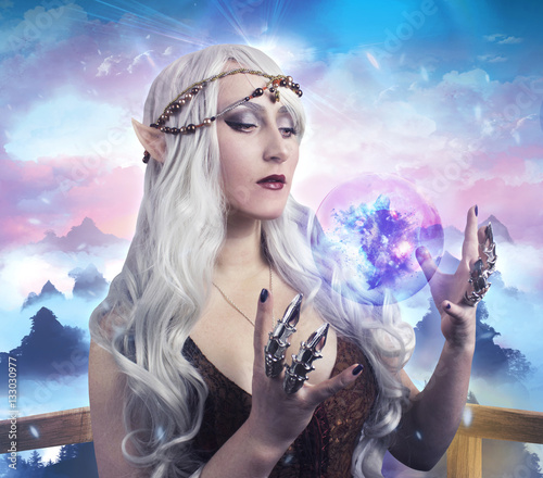 Fototapety, obrazy: Elf girl photo. Beautiful elf girl holding a magic ball on fantasy background photo.