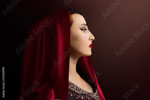 66e49ee3f3beb Renaissance woman photo. Beautiful Renaissance woman in a red head scarf  profile view portrait photo
