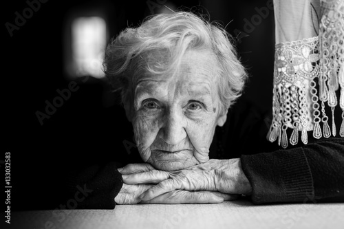 Grandma. Closeup black and white portrait of an elderly woman.