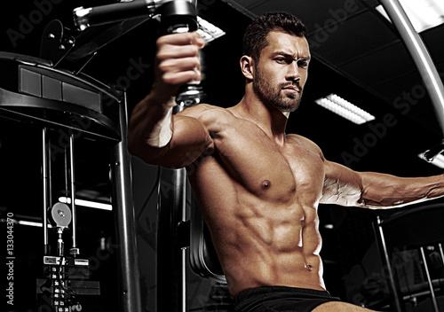 Fotografie, Obraz  Bodybuilder posing in the gym