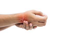 Man Massaging Painful Wrist On...
