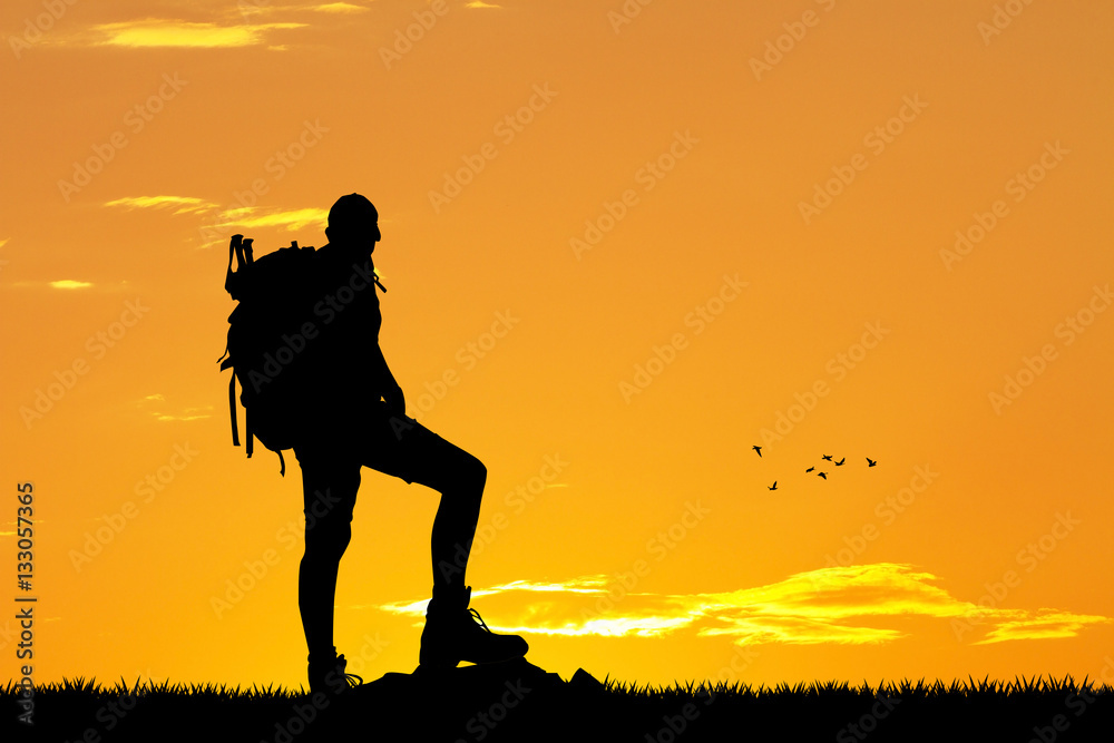 Fototapety, obrazy: man trekking on mountain at sunset