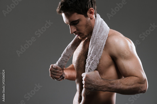 Photo sur Toile Gymnastique Attractive athlete over grey background holding towel.