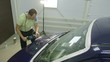 Polishing blue car with reflection, the concept car care