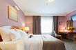 Interior of a new modern hotel double bed bedroom