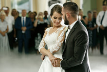 Groom Holds Bride Carefully Dancing In The Smoke