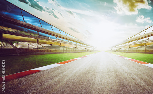 Photo Stands Motor sports View of the infinity empty asphalt international race track, digital imaging recomposition montage background . evening scene .