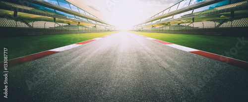 Poster Motorsport View of the infinity empty asphalt international race track, digital imaging recomposition montage background . evening scene .