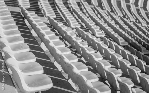 Empty seats at soccer stadium , black and white