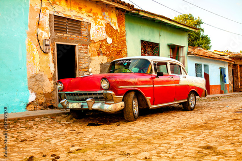 Photo Red Classic Car in the colonial town of Trinidad, Cuba