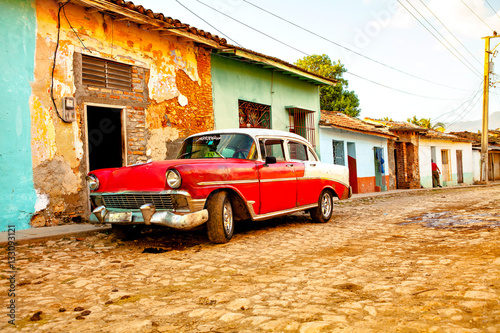 Red Classic Car in the colonial town of Trinidad, Cuba Wallpaper Mural