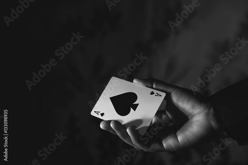 Photo  Ace Spade Card in Hand, Black and White Color