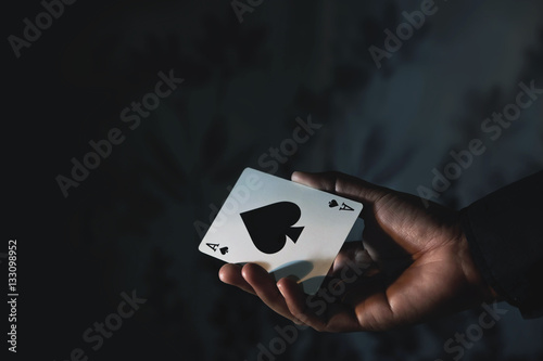 Ace Spade Card in Hand, Low-key lighting Poster