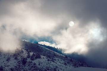 Dramatic pictersque landscape of snowy winter mountains covered