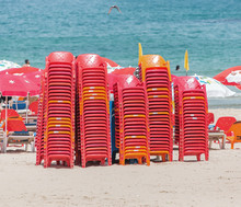 Сolorful Chairs Are Stored On The Mediterranean Coast At The Beach Of Tel Aviv - Israel
