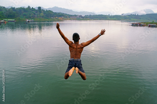 A man jumping off the bridge
