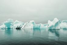 Icebergs Reflected On Sea