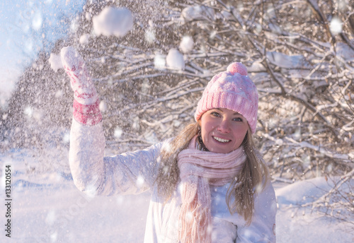 54da5d49b6f980 Winter snow fight happy girl throwing snow playing outside. Joyous young white  woman having fun