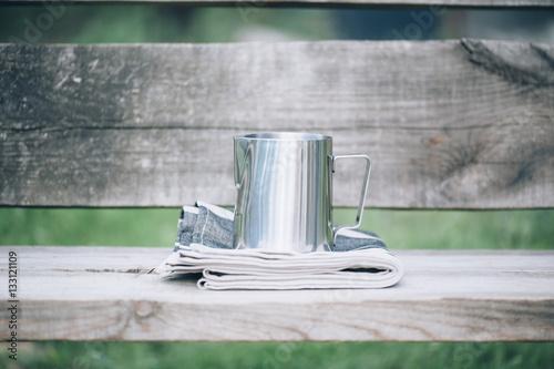 Obraz na plátně Frothing milk pitcher on the cloth napkin on the wooden background