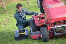 Young Man Repairing Ride On Mower