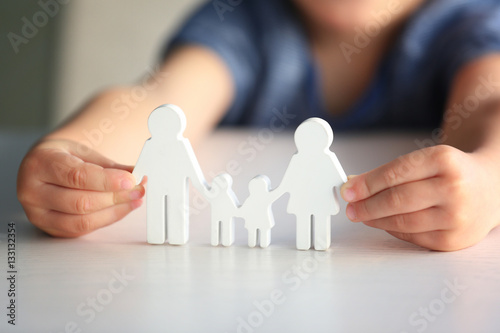 Child holding figure in shape of happy family, closeup Canvas Print