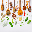 Various herbs and spices in wooden spoons. Flat lay of spices in