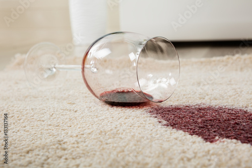 Fotografering  Red Wine Spilled From Glass On Carpet