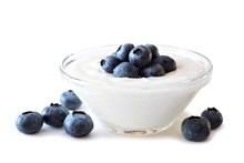 Clear Bowl Of Yogurt With Blue...