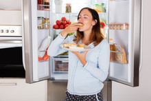 Woman Eating Sweet Food Near R...