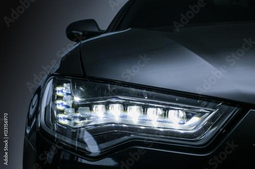 Obraz headlight of prestigious car close up - fototapety do salonu